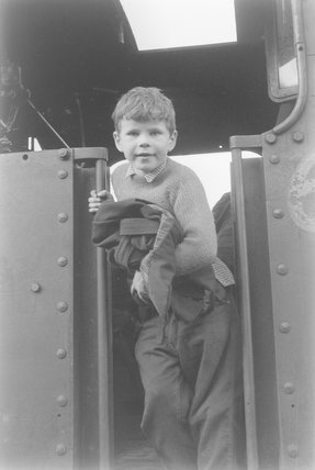 A young boy in a steam locomotive cab,A1969.70/Box 5/Neg 1251/31