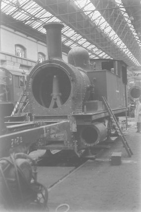 A steam locomotive under repair in a workshop,A1969.70/Box 5/Neg 1251/33