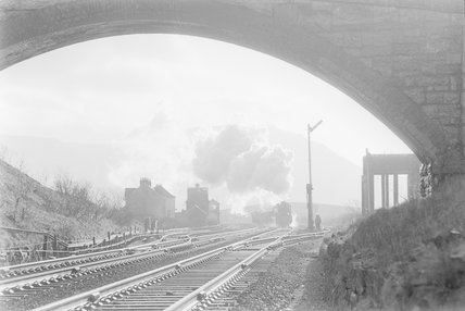 A steam locomotive approaching a bridge,A1969.70/Box 5/Neg 1253/18