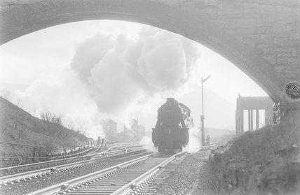 A steam locomotive approaching a bridge,A1969.70/Box 5/Neg 1253/19