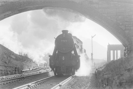 A steam locomotive approaching a bridge,A1969.70/Box 5/Neg 1253/20