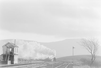 A steam locomotive approaching a signal box, distant view,A1969.70/Box 5/Neg 1253/21
