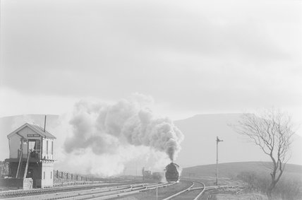 A steam locomotive approaching a signal box,A1969.70/Box 5/Neg 1253/22