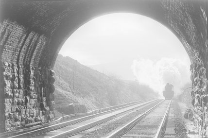 A steam locomotive approaching a tunnel, view from inside the tunnel mouth,A1969.70/Box 5/Neg 1254/13