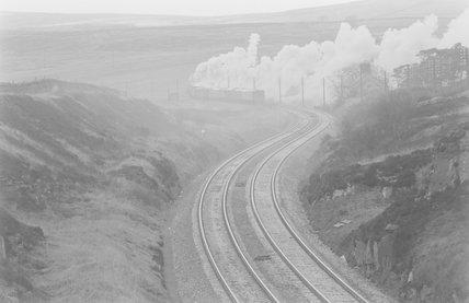 A steam locomotive hauling a goods train, distant view,A1969.70/Box 5/Neg 1255/30