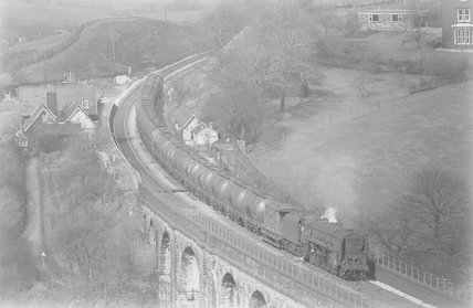 A steam locomotive hauling a tanker train across a viaduct, view from above,A1969.70/Box 5/Neg 1256/33