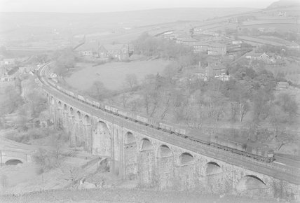 A diesel locomotive hauling a goods train across a viaduct, view from above,A1969.70/Box 5/Neg 1256/35