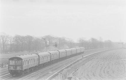 A diesel locomotive pulling a passenger train,A1969.70/Box 5/Neg 1257/9