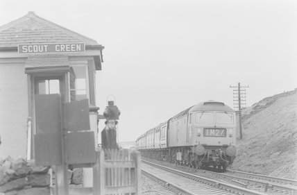 A diesel locomotive pulling a passenger train, passing signal box,A1969.70/Box 5/Neg 1257/10