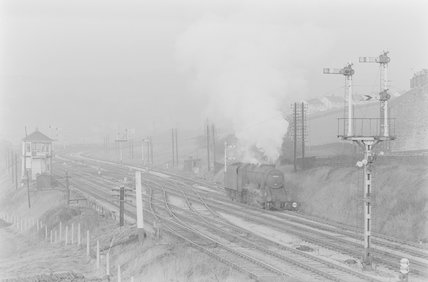 A steam locomotive passing a signal box at a junction,A1969.70/Box 5/Neg 1259/2