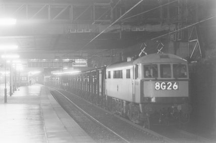 A diesel locomotive with goods train 8G26 in a station at night,A1969.70/Box 5/Neg 1260/28