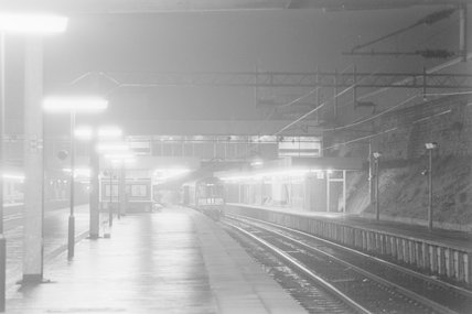A diesel locomotive with passenger train B1 in a station at night,A1969.70/Box 5/Neg 1260/29