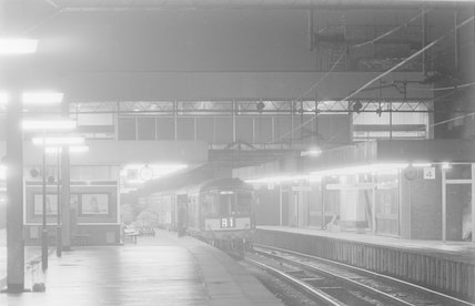 A diesel locomotive with passenger train B1 in a station at night,A1969.70/Box 5/Neg 1260/30