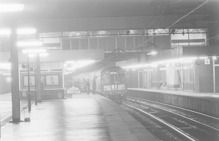 A diesel locomotive with a passenger train B1 in a station at night,A1969.70/Box 5/Neg 1260/32