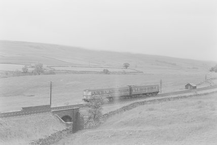A diesel passenger train passing over a bridge between fields,A1969.70/Box 5/Neg 1261/2