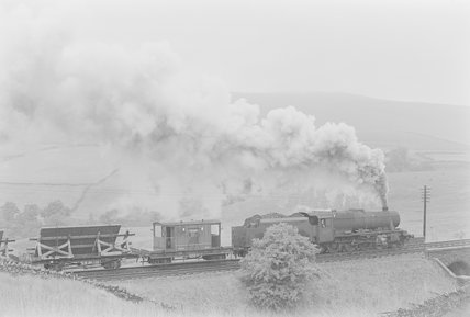 A steam locomotive hauling a goods train, passing over a bridge between fields,A1969.70/Box 5/Neg 1261/6