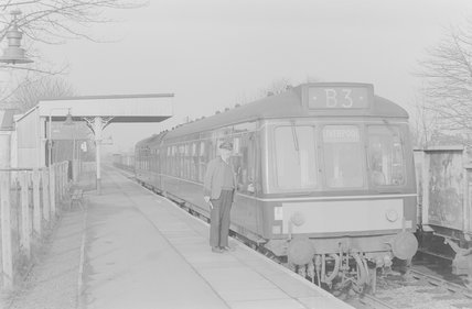 Photographic negative taken by John Clarke of the diesel 11.25 passenger train B3 to Liverpool, with the driver standing by the cab,A1969.70/Box 5/Neg 1263/29