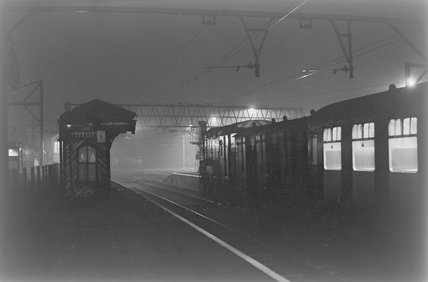 A diesel electric shunter with passenger carriages, photograph taken at night,A1969.70/Box 5/Neg 1264/16