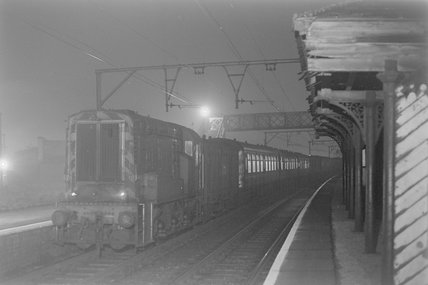 A diesel electric shunter with passenger carriages, photograph taken at night,A1969.70/Box 5/Neg 1264/18