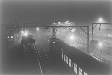 A diesel electric shunter with passenger carriages, photograph taken at night,A1969.70/Box 5/Neg 1264/19