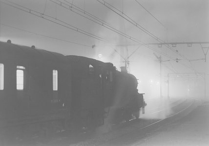 A steam locomotive with a passenger train, photograph taken at night,A1969.70/Box 5/Neg 1264/21