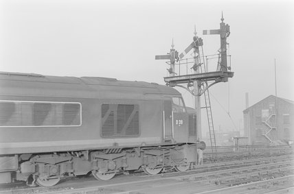 A diesel locomotive passing a signal gantry<br/>. Locomotive number: D39,A1969.70/Box 5/Neg 1265/23
