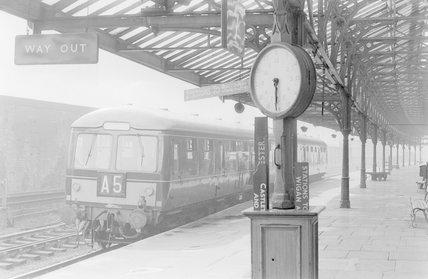 A diesel locomotive with passenger train A5 at a platform,A1969.70/Box 5/Neg 1266/8