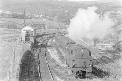 A steam locomotive shunting a passenger train,A1969.70/Box 5/Neg 1267/4