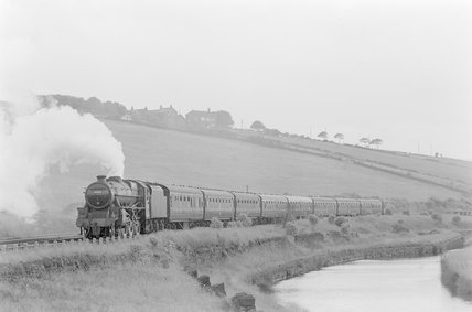 A steam locomotive pulling a passenger train alongside a canal,A1969.70/Box 5/Neg 1267/6