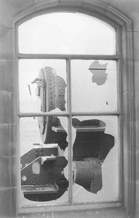 A steam locomotive through a broken window,A1969.70/Box 5/Neg 1268/12