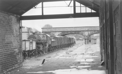 A steam locomotive with a goods train at a disused station,A1969.70/Box 5/Neg 1268/13