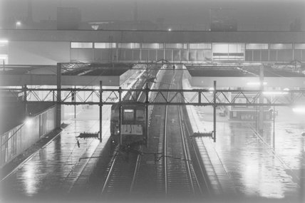 A passenger train in a station, photograph taken at night,A1969.70/Box 5/Neg 1269/23