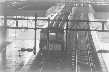 A passenger train in a station, photograph taken at night,A1969.70/Box 5/Neg 1269/24