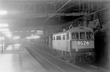 A passenger train in a station, photograph taken at night,A1969.70/Box 5/Neg 1269/27