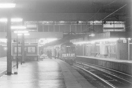 A diesel locomotive with passenger train B1 in a station, photograph taken at night.,A1969.70/Box 5/Neg 1270/33