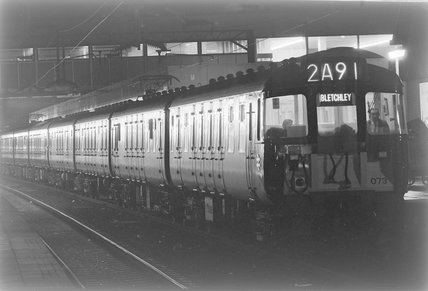 A diesel locomotive with a passenger train 2A91 to Bletchley in a station, photograph taken at night.,A1969.70/Box 5/Neg 1270/36