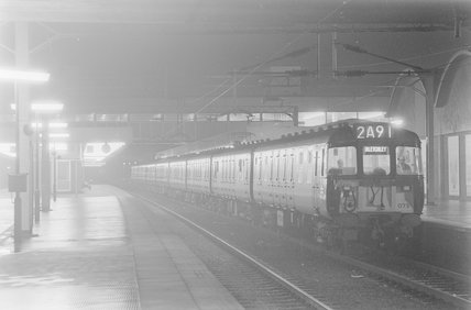 A diesel locomotive with passenger train 2A91 to Bletchley in a station, photograph taken at night.,A1969.70/Box 5/Neg 1270/37