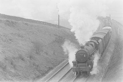 A steam locomotive hauling a goods train, entering a cutting. ,A1969.70/Box 5/Neg 1271/3