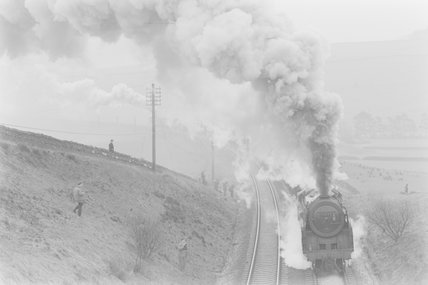 A steam locomotive entering a cutting, with trainspotters on a hillside. ,A1969.70/Box 5/Neg 1271/7