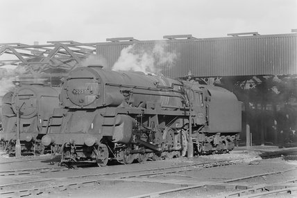 Photographic negative taken by John Clarke of steam locomotives outside a shed. ,A1969.70/Box 5/Neg 1272/2