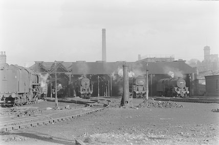 Photographic negative taken by John Clarke of steam locomotives outside a shed. ,A1969.70/Box 5/Neg 1272/4