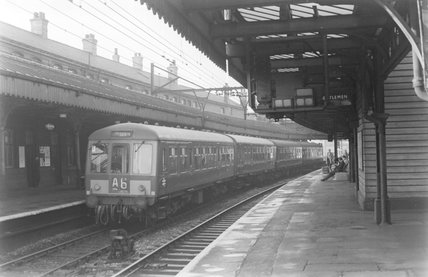 A diesel locomotive with passenger train A6 at a platform. ,A1969.70/Box 5/Neg 1273/8