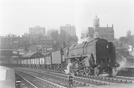 A steam locomotive hauling a goods train, leaving the station. ,A1969.70/Box 5/Neg 1273/10