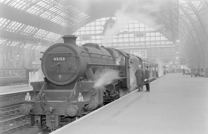 A steam locomotive with a passenger train at a platform. ,A1969.70/Box 5/Neg 1274/23