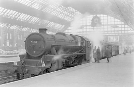 A steam locomotive with a passenger train at a platform. ,A1969.70/Box 5/Neg 1274/24