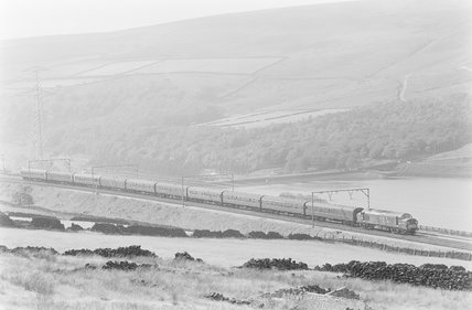 An electric locomotive pulling a passenger train, distant view from above. ,A1969.70/Box 5/Neg 1276/13