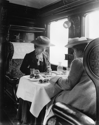 Female passengers in a LNWR dining carriage, c 1905.