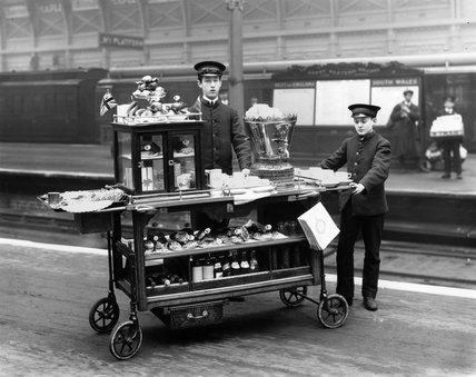 Two attendants with a refreshments trolley, 1915.