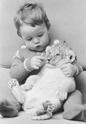 Boy and lion cub