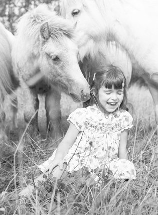 Girl with ponies